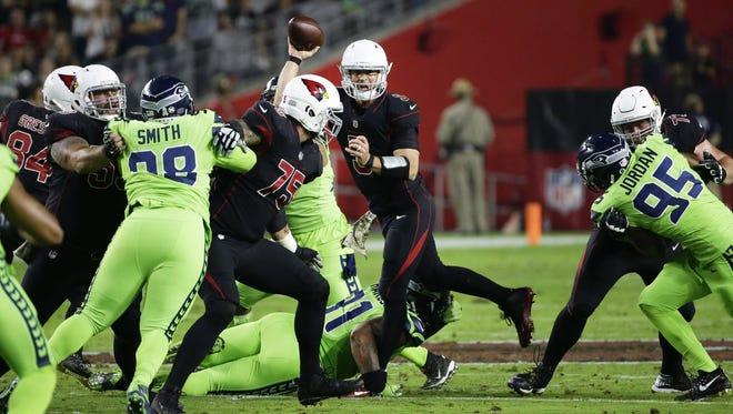 Arizona Cardinals quarterback Drew Stanton is hurt on this play as Seattle Seahawks Sheldon Richardson dives at his knee in the first half on Nov. 9, 2017 at University of Phoenix Stadium in Glendale, Ariz.