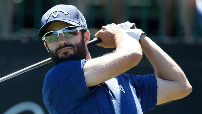 Adam Hadwin hits his drive one the first hole during the final round of the Arnold Palmer Invitational golf tournament at Bay Hill Club & Lodge .