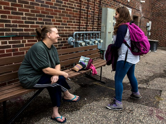 Danielle, left, who declined to give her last name, talks to her daughter Adriana, 14, after she got home from school, outside the House of Mercy, a home for single mothers and their children who would otherwise be homeless, in Loyal, Wis., on September 26, 2017.
