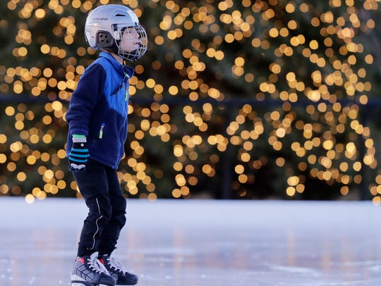 Ben Renkas, 6, of De Pere, skates past the Christmas