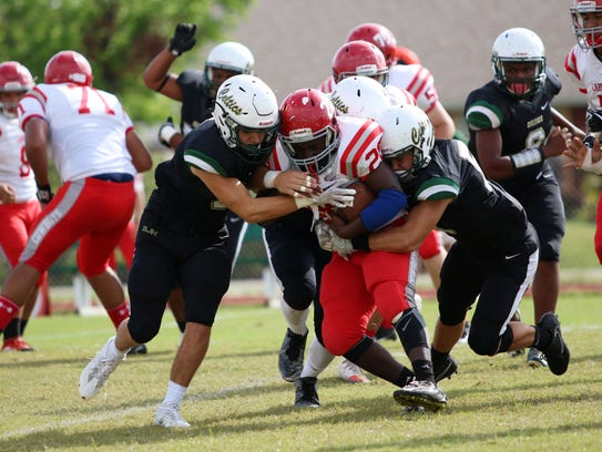 The Celtic defense takes down LaBelle running back