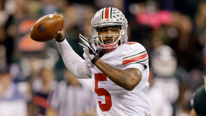 FILE - In this Dec. 7, 2013, file photo, Ohio State quarterback Braxton Miller throws a pass against Michigan State during the Big Ten Conference championship NCAA college football game in Indianapolis. Miller was the first  Big Ten MVP winner in 24 years after he threw for 2,094 yards and 24 touchdowns and rushed for 1,068 yards and 12 TDs. (AP Photo/Michael Conroy)