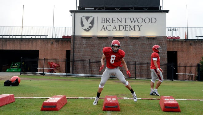 Brentwood Academy linebacker Devyn Curtis runs a drill during practice Monday.