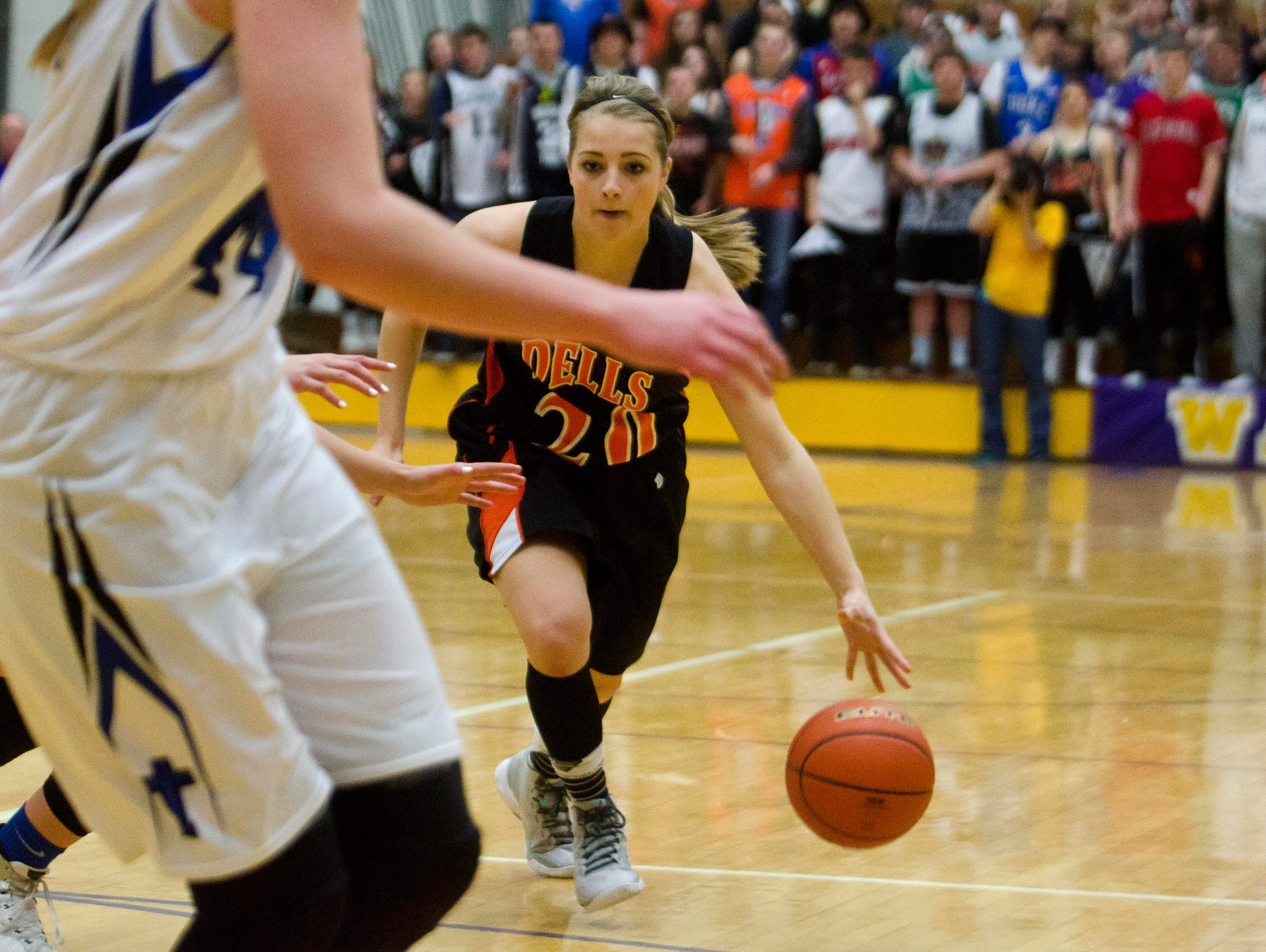 Dell Rapids' Kaylee Hennen drives around a St. Thomas More defender Thursday, March 10, in the Class A state quarterfinals at Watertown Civic Arena. Hennen scored one point. Micah Bader/Dell Rapids Tribune