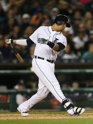 Detroit Tigers designated hitter Victor Martinez strikes out with the bases loaded in the seventh inning against the Minnesota Twins on Wednesday, May 13, 2015 at Comerica Park in Detroit.