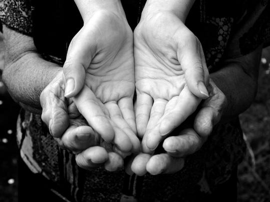 Empty hands being held by more hands