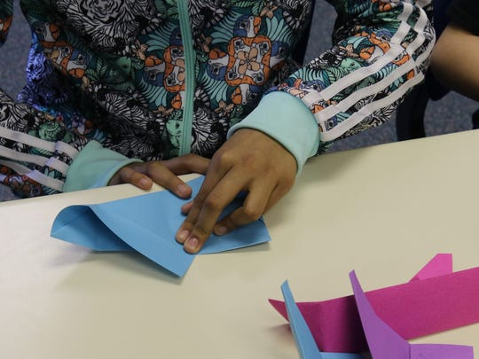 A Mesa Verde Elementary School students folds construction paper Thursday as part of an origami program taught by Tricia LeSuer. The program is designed to introduce students to geometry concepts.