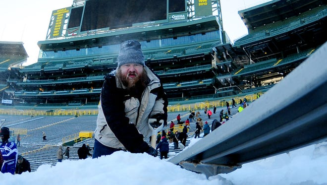 Carl VanCaster of Green Bay joined hundreds of shovelers in January to remove snow from the stands inside Lambeau Field in preparation for a divisional playoff game against Dallas.