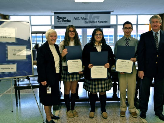 Rahway residents Bryant Flores, Class of 2015, and Magdalena Lyszczak, Class of 2017, Elizabeth resident Moises Oliveri, Class of 2017, and Scotch Plains resident Julia Bonavitacola, Class of 2017, were recently awarded the 2014-15 Navin Brothers Food Service Scholarship at Union Catholic High School in Scotch Plains. The scholarship was established in memory of Mary Ellen Swinden, a Navin Bros. employee who worked at Union Catholic and died in the fall of 2008. The scholarship recipients were selected based on their academic standing at Union Catholic as well as their involvement in extra-curricular activities. Navin Bros. oversees all food service operations at Union Catholic High School as well as at schools throughout the New York tri-state area. Pictured left to right are Sister Percylee Hart, principal; Magdalena Lyszczak; Julia Bonavitacola; Moises Oliveri; and Joseph Navin Jr.