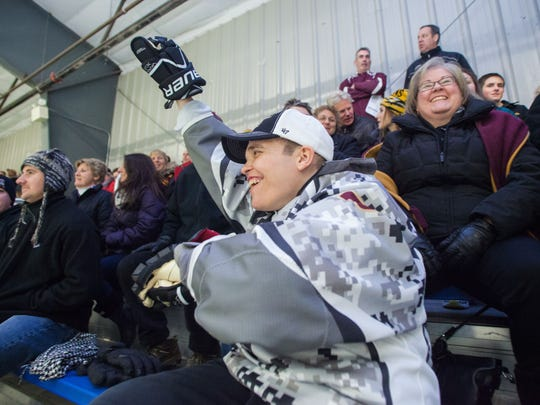 Christian Sell celebrates a Norwich goal at the Cairns Arena, in South Burlington, on Friday.