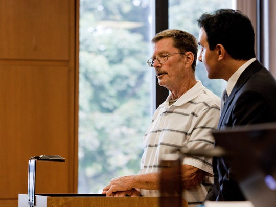 James Bernard VanCallis, 66, stands next to his lawyer, Dean Ankouny, during a preliminary hearing Aug. 19, 2014 at the St. Clair County Courthouse in Port Huron.