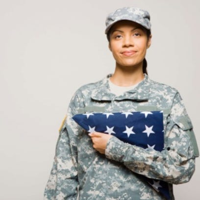 A soldier holds an American flag