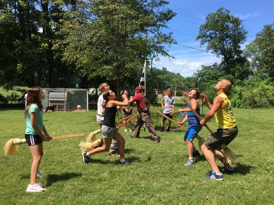 On Sunday, Aug. 13, 2017 at Mia and Chris Pugh's home in Churchville, players from the four houses of Hogwarts practice quidditch in preparation for Staunton, Virginia's Queen City Mischief & Magic Sept. 22-24, 2017.  Game 1 will open the Hogwarts Homecoming Quidditch Games when houses Hufflepuff and Ravenclaw enter the stadium in downtown Staunton 6 p.m. Friday, Sept. 22. Game 2 will follow at 7 p.m. with Gryffindor vs. Slytherin. Winners of games 1 and 2 duke it out at 8 p.m. to determine who will be victorious. Pictured left to right: Cassidy Brown – Hufflepuff; Cody Madison – Slytherin; Karmen Warren – Ravenclaw; Carter Deitz  – Gryffindor; Tristan Deitz – Gryffindor; Austin Clements – Slytherin. The Pughs, of Medieval Fantasies Company, return as The Founders of Hogwarts and organize the Hogwarts Homecoming Quidditch Games. During the games, Chris, Godric Gryffindor, will act as head referee and Mia, Helga Hufflepuff, will be score keeper. Founders Rowena Ravenclaw and Salazar Slytherin, Dianna and Dan Pittman, will also assist in the games.