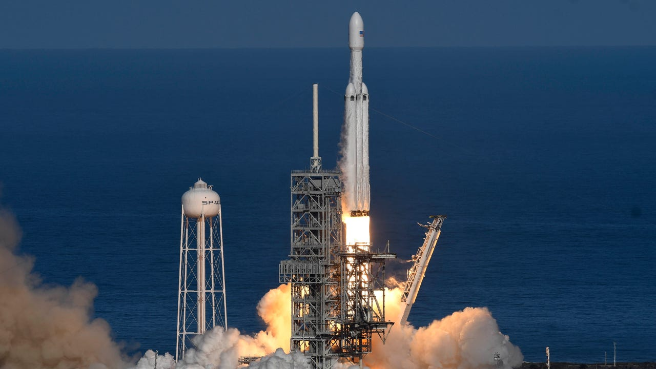 SpaceX launched its Falcon Heavy rocket from Kennedy Space Center on Tuesday, Feb. 6, 2018 and landed two of the side boosters at Cape Canaveral Air Force Station.