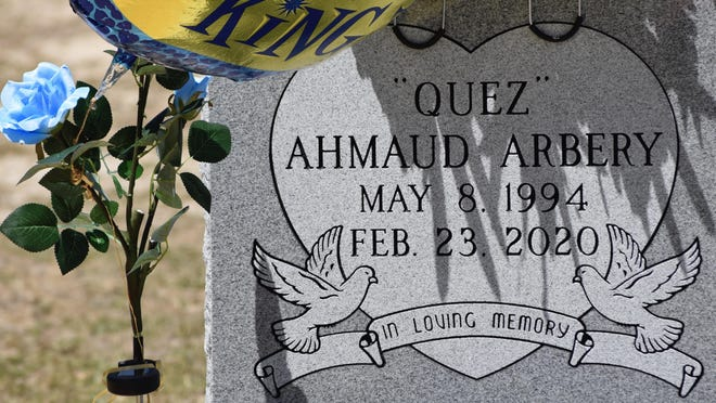 Ahmaud Arbery's grave is decorated with flowers and birthday balloons. If he had not been murdered, he would have turned 26 last Friday.