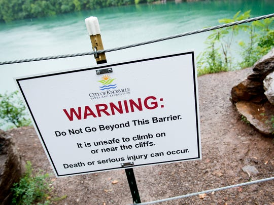 A warning sign on the ledge at Fort Dickerson Quarry
