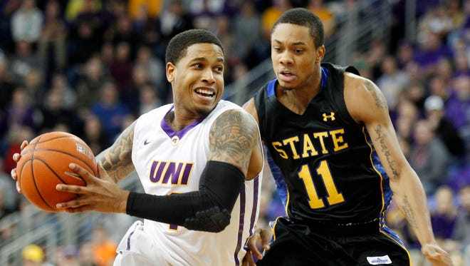 Northern Iowa's Deon Mitchell, left, gets past South Dakota State's George Marshall during the first half of an NCAA college basketball game Sunday, Dec. 28, 2014 in Cedar Falls, Iowa.