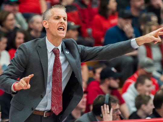 Gardner Webb coach Tim Craft sends in play against Radford during the first half of the Big South conference NCAA basketball championship game in Radford, Va., Sunday, March 10, 2019. (AP Photo/Lee Luther Jr.)