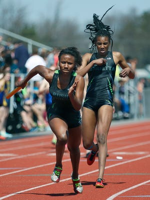 Rush-Henrietta's Lanae-Tava Thomas takes off with the baton after it was handed to her by Ceara Watson in the sprint medley relay during at the R-H Relays on April 18, 2015.