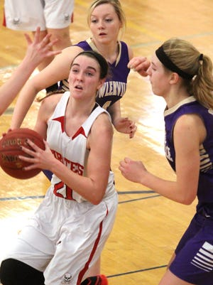 Surrounded by Fowlerville's Paige Boden, left, and Lexa Elzerman, right, Pinckney's Shannon Dingman, center under the basket prepares to shoot for two.