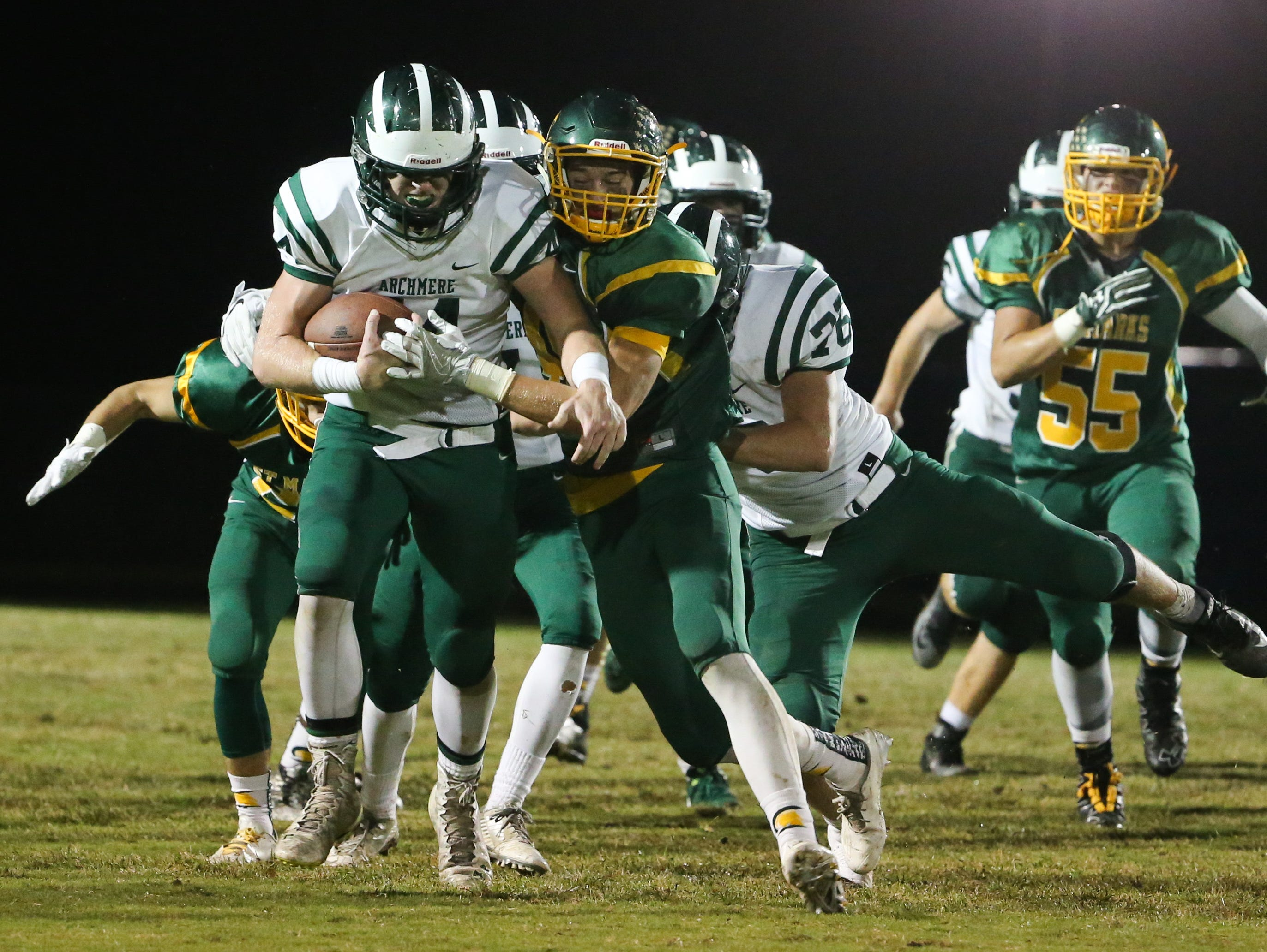Archmere running back Patrick Udovich is tackled by St. Mark's defensive end David Balint in the second quarter.