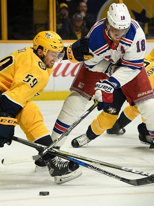 New York Rangers defenseman Marc Staal (18) tries to shoot the puck past Nashville Predators defenseman Roman Josi (59) in the first period of an NHL hockey game Saturday, Feb. 3, 2018, in Nashville, Tenn. (George Walker IV/The Tennessean via AP)