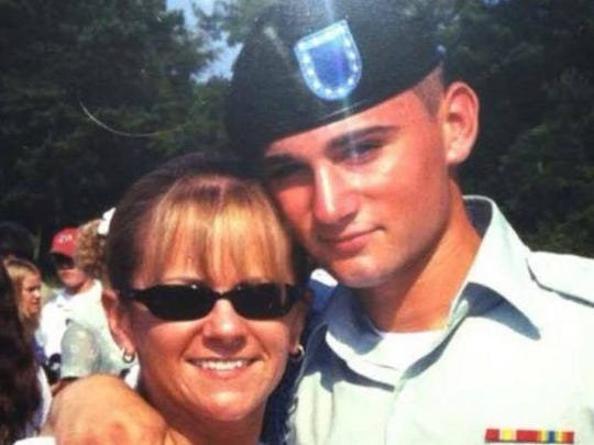Justin Richardson poses for a photo with his mother after completing basic training at Fort Benning.