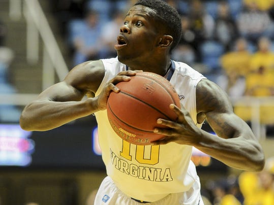 FILE - In this Nov. 21, 2013 file photo, West Virginia's Eron Harris (10) looks to pass during the second half of an NCAA college basketball game against Georgia Southern in Morgantown, W.Va. High-scoring guard Eron Harris is transferring to Michigan State from West Virginia. His father, Eric Harris, says Monday, June 9, 2013,  that offers were turned down from Michigan, Wisconsin, Purdue and UCLA. (AP Photo/Andrew Ferguson, File)