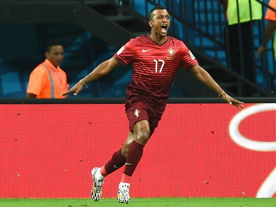 Portugal's Nani celebrates after scoring the opening goal during the group G World Cup soccer match between the USA and Portugal at the Arena da Amazonia in Manaus, Brazil, Sunday, June 22, 2014.  (AP Photo/Paulo Duarte)