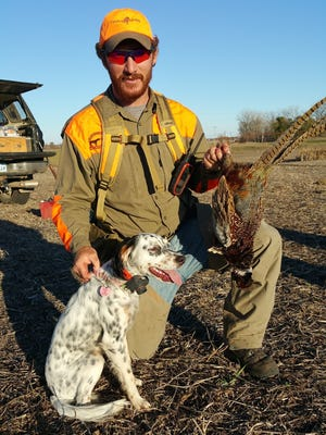 Tate Martinsen, with Madison, on a beautiful fall day of pheasant hunting in South Dakota.