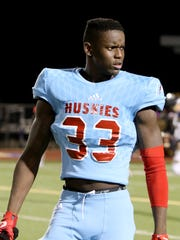 Hirschi's Ezekiel Holmes reacts after the Huskies 31-21 loss to Stephenville Friday, Dec. 8, 2017, at Ranger Stadium in Fort Worth.