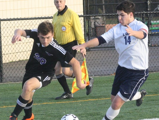 Franklin's Bobby Mandrink (14) pinches a Woodhaven