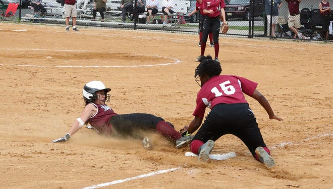 Bloomfield's Jalia Santos tagging out a would-be base stealer from Ridgewood at third.