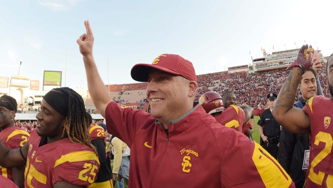 Clay Helton and the Southern California Trojans will try to be more balanced offensively than they were when they lost to Stanford in September.