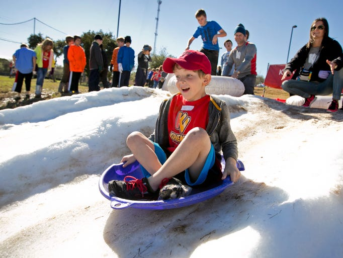 Kase Knussman sleds down a hill with 30,000 lbs. of