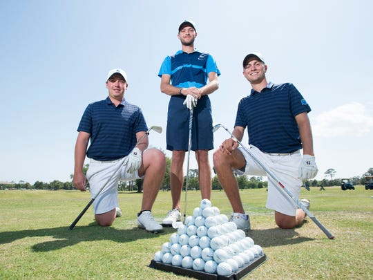University of West Florida golfers Henry Westmoreland IV, from left, Christian Bosso, and Chandler Blanchet pose on the driving range at the Pensacola Country Club on Thursday, April 19, 2018.  The UWF team, currently at the top of the men's pyramid,  stands in first place in the NCAA Division II.