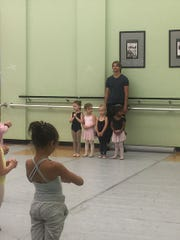 "Artem Yachmennikov and Ekaterina Vaganova-Yachmennikova own the Melbourne City Dance Center in Melbourne. Here Artem rehearses with the  ""Little Angels"" for the Space Coast Ballet Company's 2016 presentation of ""The Nutcracker."""