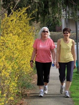 Longtime friends Louise Edleman, left, and Christina Lange are photographed while walking in Pleasantville.
