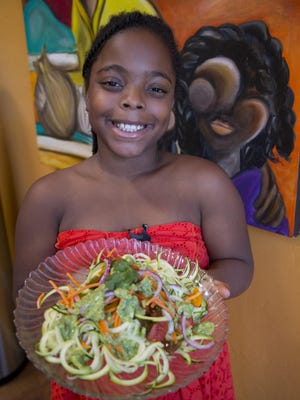 "Nia Thomas, 10, of Tucson, is one of the winners of the Healthy Lunchtime Challenge who will be heading to the White House next month to attend a Kids' ""State Dinner"" and meet the First Lady. Thomas shows off her winning dish called, ""Oodles of Zoodles with Avocado Pistachio Pesto in her Tucson home."