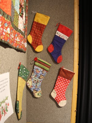 The Zia Quilting and Stitchery Guild showcase their stockings.