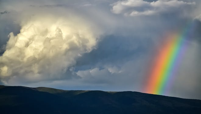 Beautiful rainbow and dense clouds after the rain.