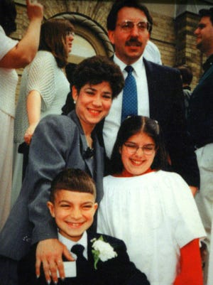 An undated copy photo of Jim and Pat Viola with their young children Michael and Christine.