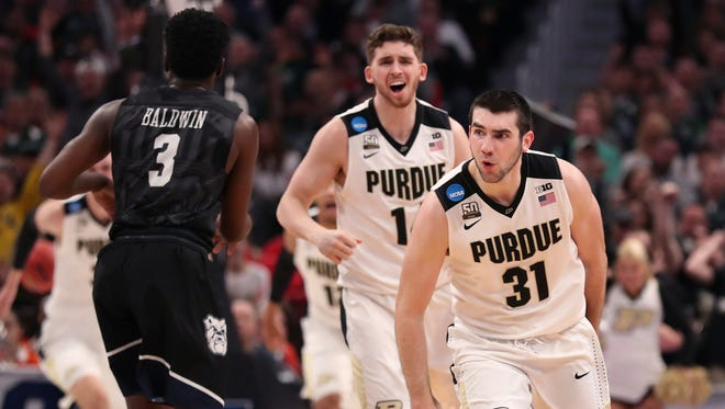 Purdue guards Ryan Cline and Dakota Mathias (31) celebrate as their team defeats Butler during the second half of a second-round game in the NCAA college basketball tournament, Sunday, March 18, 2018, in Detroit.