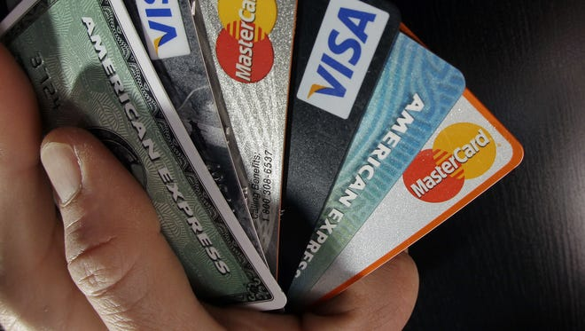 Consumers are increasingly looking online to consolidate high-cost credit card debt with a personal loan. But take time to understand costs and fees. Experts say paying off debt requires a comprehensive plan.