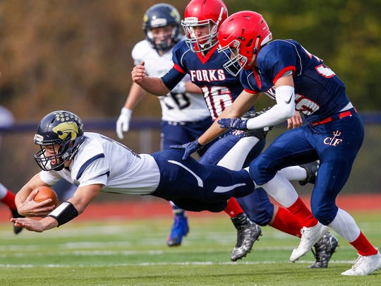 Susquehanna Valley's Daniel Matthews dives in front of Chenango Forks' Jared Gage and Sal Frontera.
