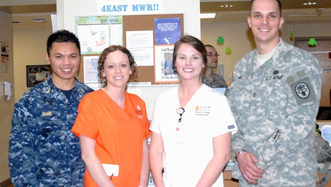 AUM and Auburn nursing students take a break from work at Walter Reed National Military Medical Center.