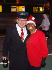 Conductor David Provost and Elf Ame Lambert at the Polar Express event in Burlington.