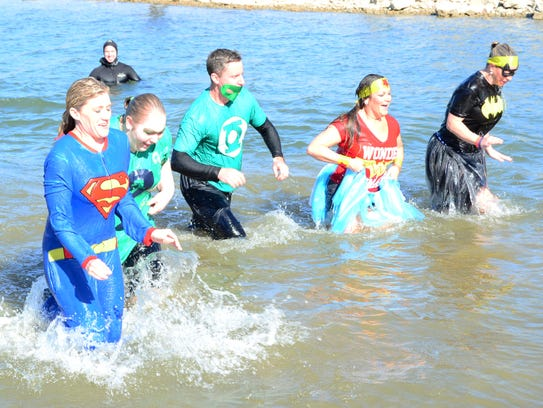 Polar plungers brave the cold at Table Rock Lake during