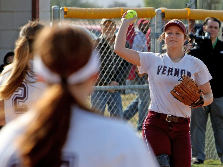 Vernon's Caitlin Brints throws the ball back to the