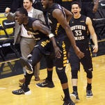 The Southern Mississippi team celebrates after a come-from-behind 63-60 victory over UTEP in an NCAA college basketball game in Hattiesburg, Miss., Saturday, Feb. 28, 2015. (AP Photo/George Clark)